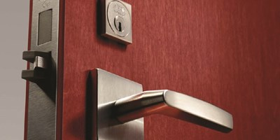 ASSA ABLOY Decorative Hardware on red door